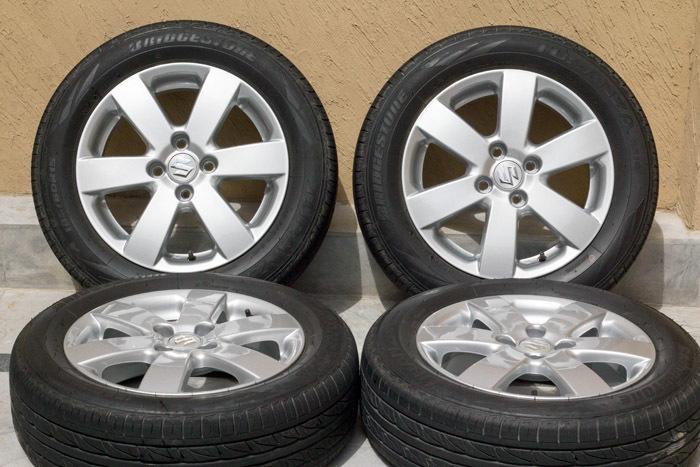 Suzuki Tire Size >> Fs Oem Suzuki Swift Rims And Tyres Car Parts Pakwheels Forums