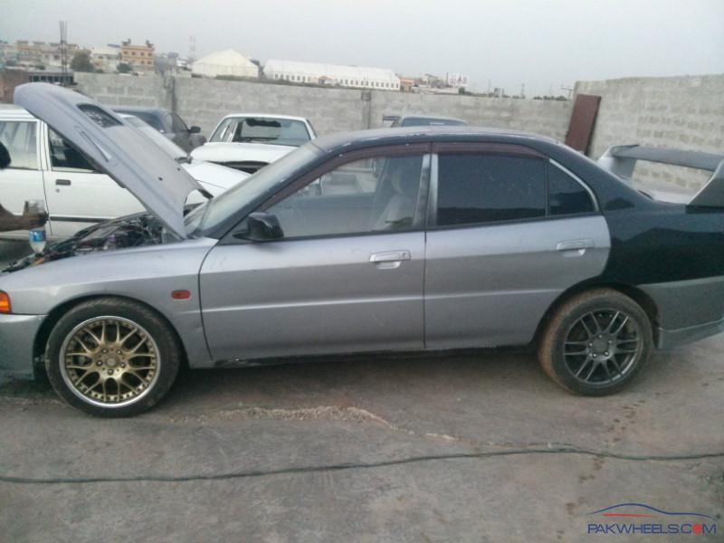 mitsubishi evo 4 half cut for sale rozzzzz car parts pakwheels forums. Black Bedroom Furniture Sets. Home Design Ideas